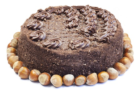 Nut meringue cake with chocolate cream photo
