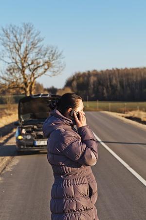 Woman calling for help near broken car Stock Photo - 13334427