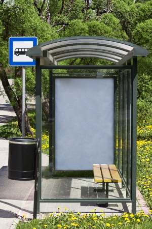 Bus stop with the ad behind the glass photo
