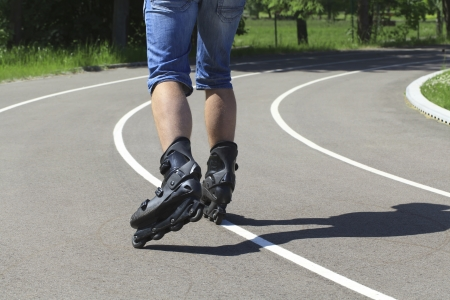 A man on roller skates in stadium