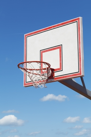 Basketball hoop on blue sky background