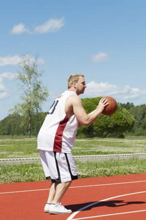 Basketball player with the ball photo