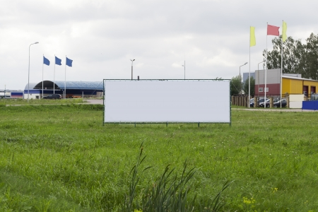 Advertising stand in a meadow near the road photo