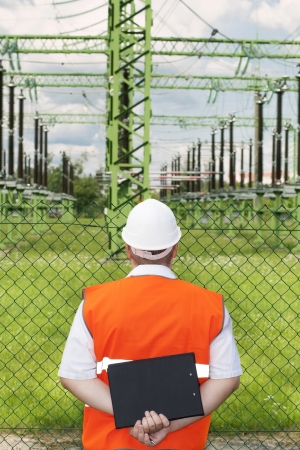 Engineer near the electricity substation Stock Photo - 14679868