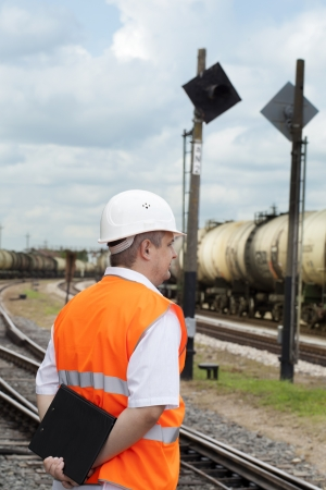 Engineer with folder at the station near the wagons Stock Photo - 14746603