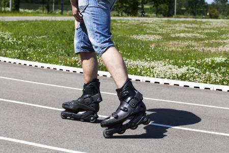 A man on roller skates in stadium in summer photo