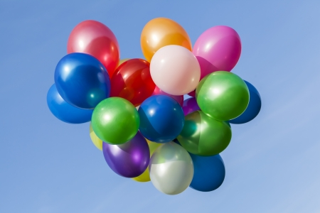 Different coloured balloons in the sky photo