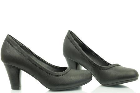 Women s shoes with a heel in black color on a white background photo