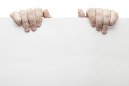 The two hands holding light grey cardboard paper