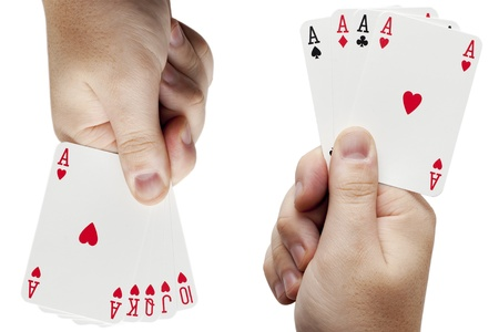 wo hands with playing cards on a white background Stock Photo - 16242491