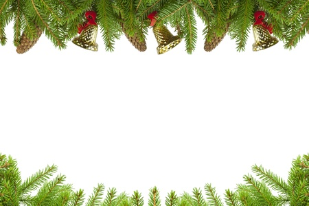 Spruce branches with cones and bells on a white background Stock Photo - 16352346