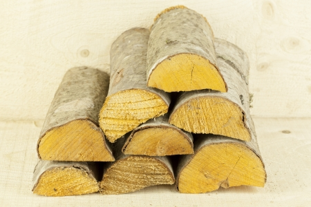 woodpile: Firewood stacked in light brown wooden box