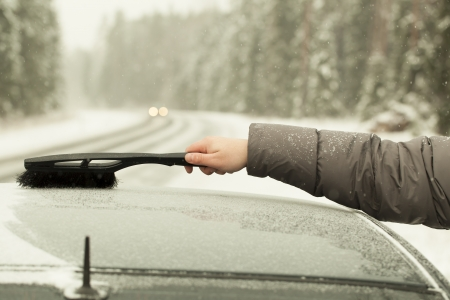 Man cleans the car out of the snow in snow storm Stock Photo - 16811581