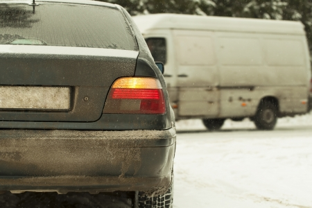 Car in snowfall  on a slippery road at the intersection of highway Stock Photo - 16811587