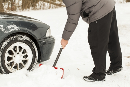 Man digging car out of the snow Stock Photo - 16890868