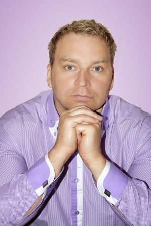 Man dressed in purple shirt on purple background Stock Photo - 16987253