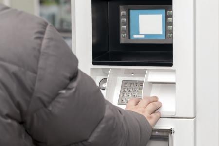 cash dispenser: Man s hand near the cash machine in Gas Station