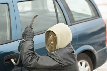 Robber with a crowbar near the car door Stock Photo - 17214620
