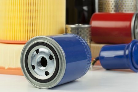 Auto oil filter on a various filter background Stock Photo - 17244141