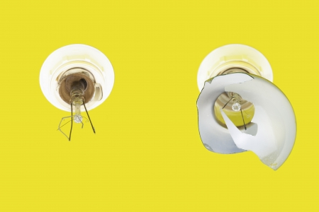 Old,damaged,exploded lamps on a yellow background photo