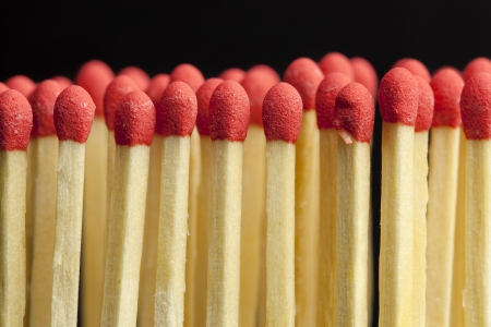 Matches in rows on a black background photo