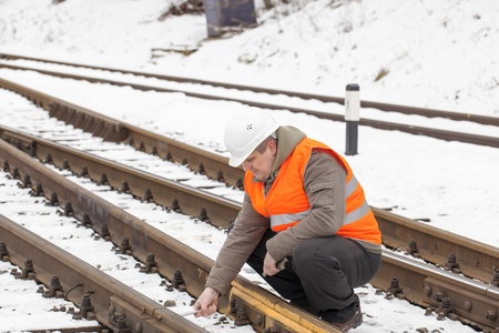 Railroad worker with adjustable wrench in the hand  photo