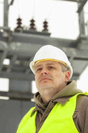 Engineer on a transformer background in winter