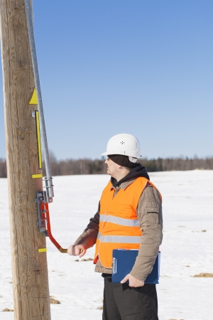 isolators: Electrical engineer inspect electric line disconnector