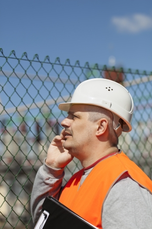 isolators: Engineer with a folder in factory site