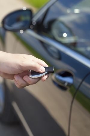 Man s hand with a car alarm remote control