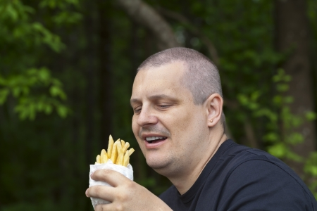 Man with potato chips photo