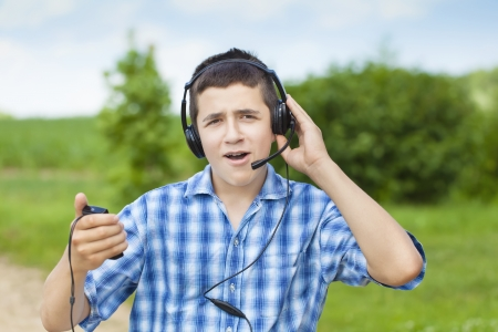 Boy with headphones and Mic photo