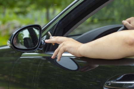 Driver with a cigarette in hand Stock Photo - 21121987