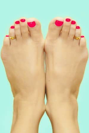 Feet with painted red nails Stock Photo