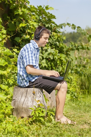 Boy with headphones, Mic and PC photo