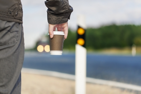 Man with coffee on the highway Stockfoto