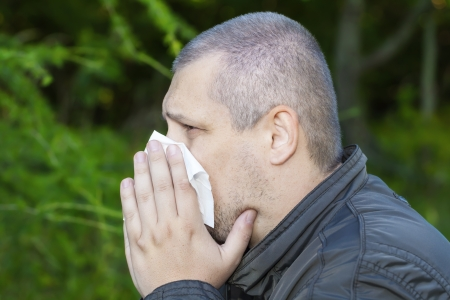 runny: Man with a runny nose and napkin