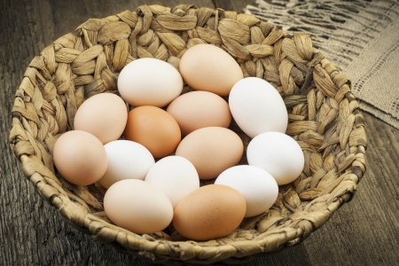 Eggs in basket on the boards photo