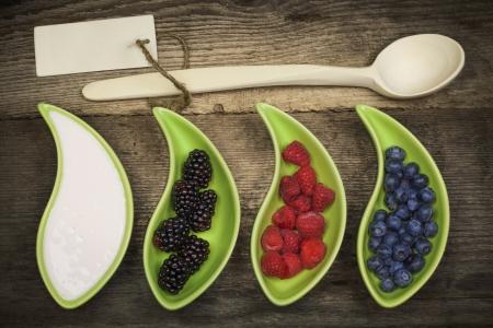 Blackberries, Raspberries, Blueberries near to the yogurt