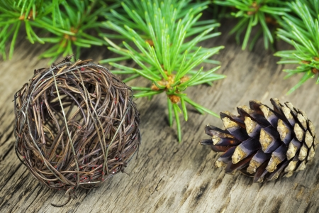 Cone with decorations and fir branches photo