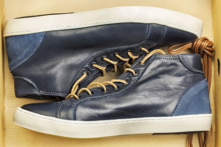New leather sneakers in the cardboard box