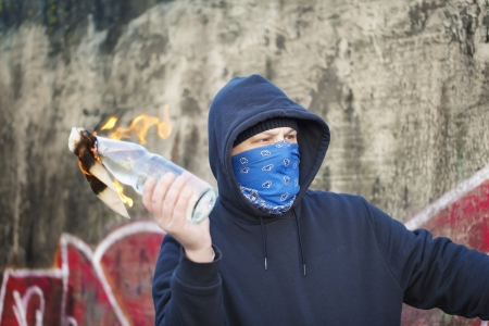 Man with a burning Molotov cocktail at the hands of Stock Photo - 24533399