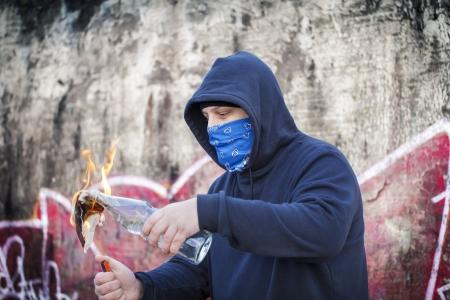 molotov: Man with burning Molotov cocktail