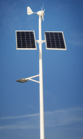 Street lighting with solar panels and wind generator photo