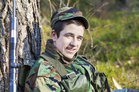 recruit: Young recruit with optical rifle in forest