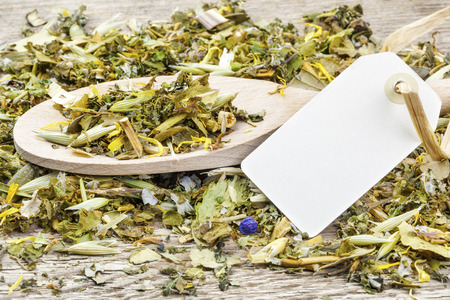curative:  Curative natural herbal tea on wooden spoon with hang tag