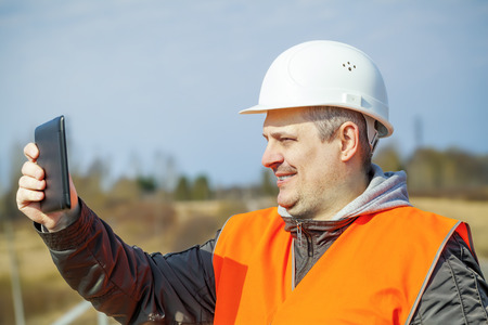 Railroad worker with tablet PC on railway