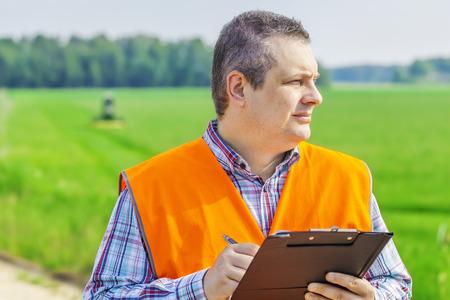 Farmer foreman near the field photo