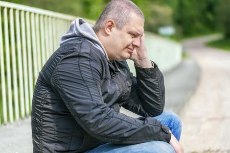 desolation: Depressed man on the bridge at outdoors