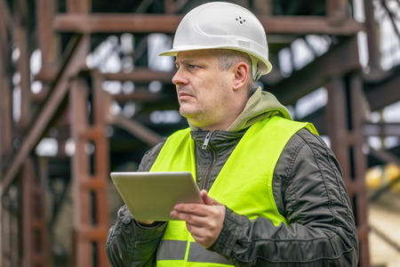 Engineer with tablet PC at factory